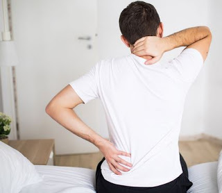 Back pain after sleeping on back