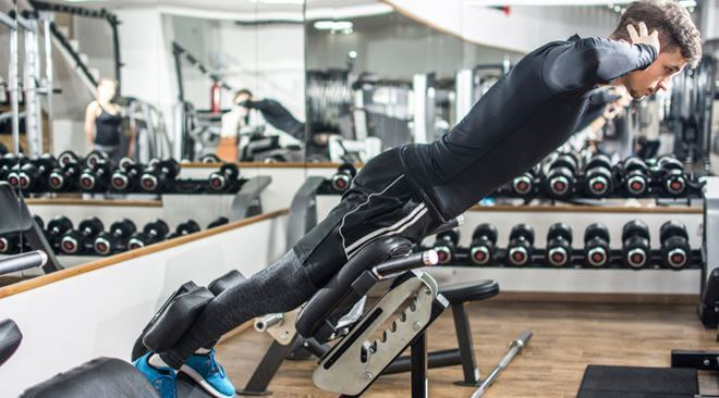 Back extension bench method with dumbbell